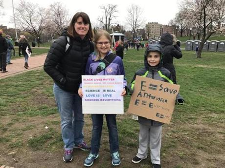 Ten-year-old twins Andrew and Kierra held signs at the March for Science in Boston